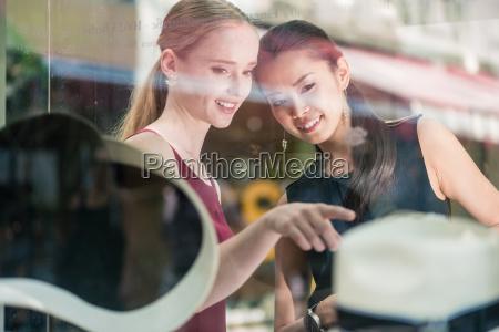 two women friends shopping in a