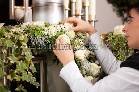 grief female mortician preparing urn
