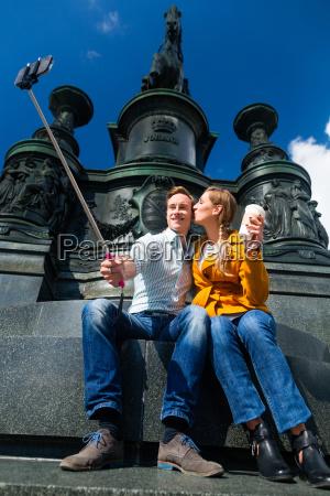 couple taking selfie on theaterplatz in