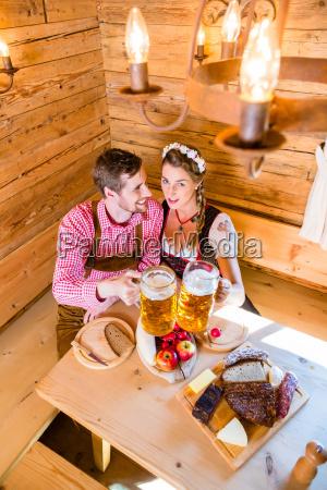 couple having dinner at mountain hut