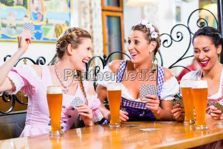 women, in, bavarian, pub, playing, cards - 21507791
