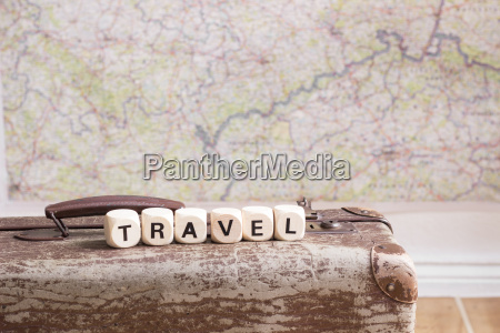 old suitcase map and word travel