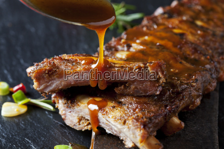 barbecue sauce dripping on marinated and
