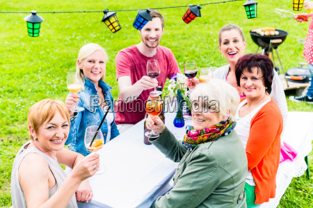 people toasting at party in the