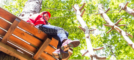 girl sitting on platform in high