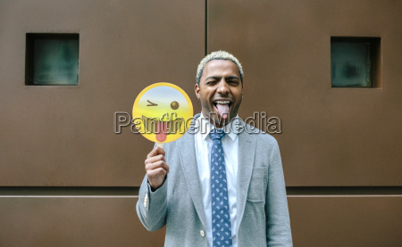 businessman holding emoji smiling with tongue