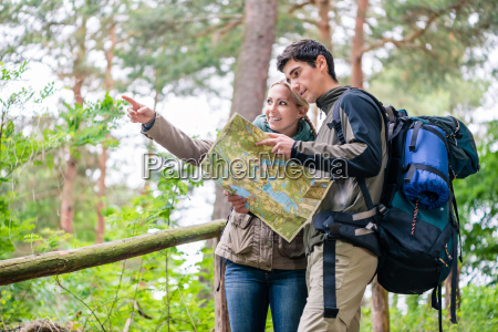 man and woman on hike looking