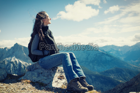 woman on mountain hike having rest