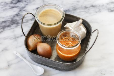 jars with tomato sauce peanut sauce