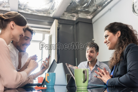 team of creatives having meeting in
