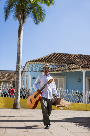 cuba walking man with guitar and