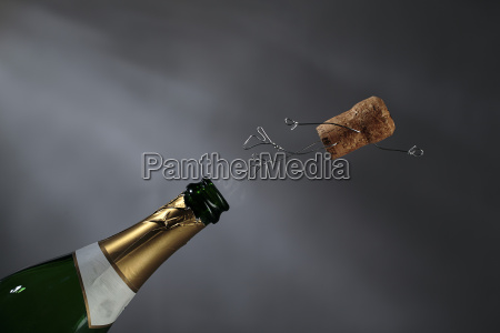 champagne cork manikin in the air