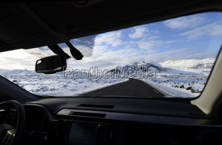 iceland road and snow capped mountain