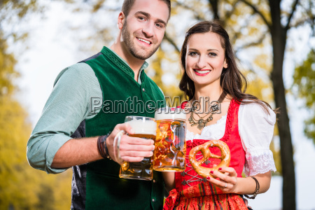bavarians in tracht with beer and