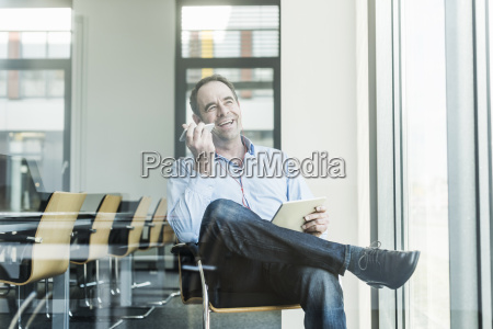 happy businessman using cell phone and