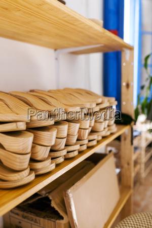 shoe lasts on shelf in shoemakers
