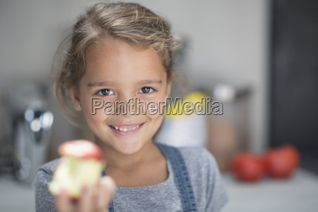 portrait of smiling girl with apple