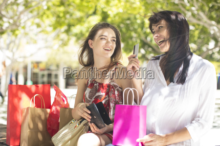 happy mother and daughter with shopping