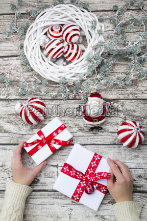 hands holding christmas presents