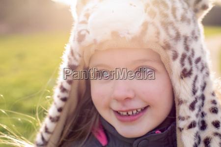 portrait of shy little girl wearing