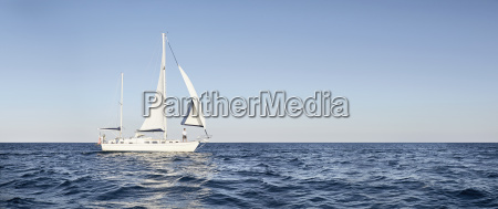man on his sailing boat on