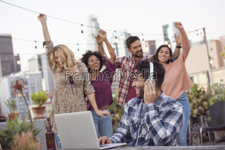 people dancing at rooftop party with