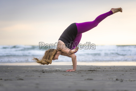 yoga on the beach in the