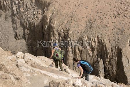 two female climbers begin a steep