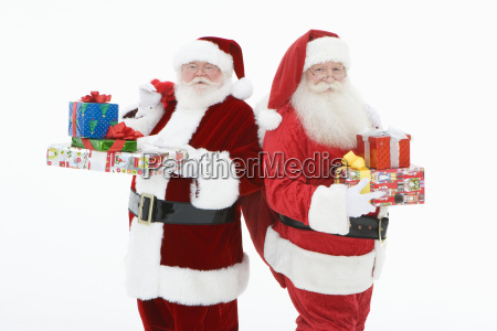 men in santa claus outfits standing