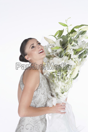 woman in evening dress accepts flower