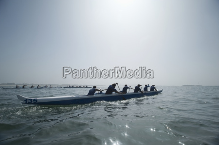 outrigger canoeing team in race