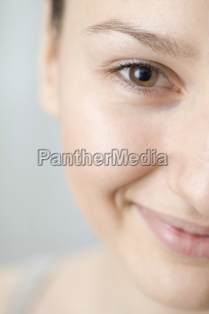 happy woman with brown eyes