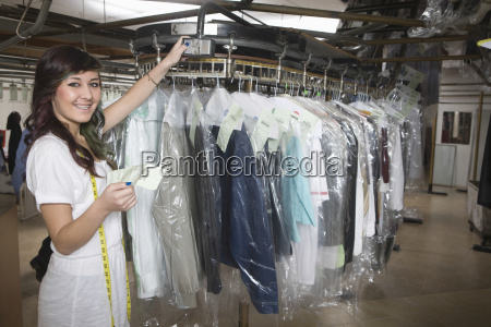 laundry owner with receipt checking clothes