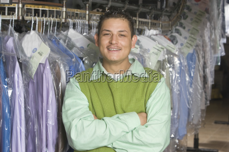 man standing in front of clothes