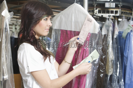 woman checking receipts of dry clean