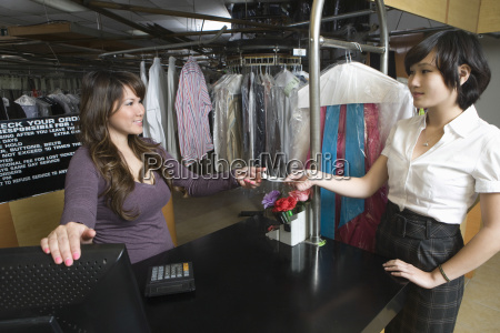 female owner receiving receipt from customer