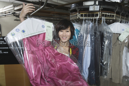 female owner displaying clean dress in