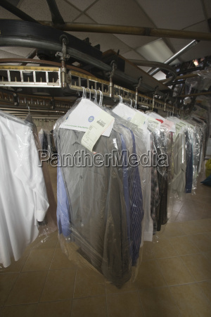various clothes on hanger in laundry