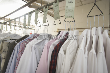 clothes hanging on hanger in laundry