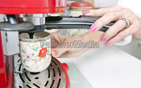 cropped image of woman dispensing coffee