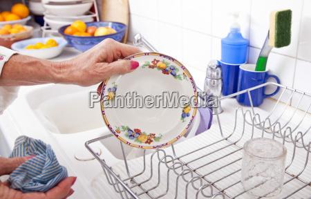 cropped image of senior woman arranging