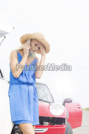 tensed young woman using cell phone