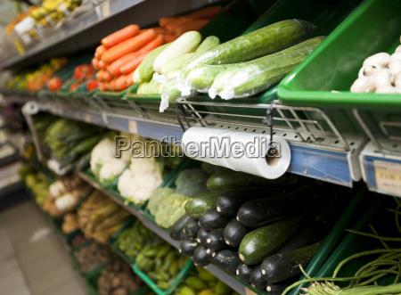 variety of vegetables on shelves in
