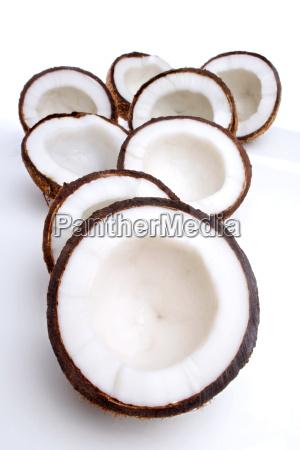 studio shot of halved coconuts