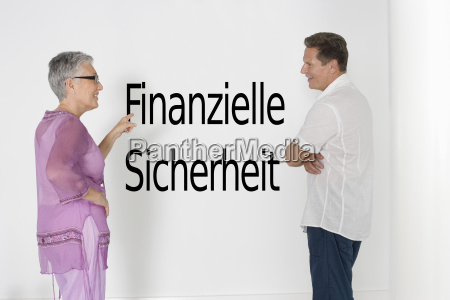 couple discussing financial security against white