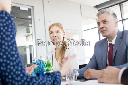 business people having discussion in board