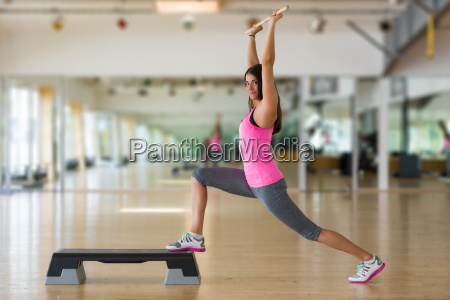 beautiful athletic woman doing stretching exercise