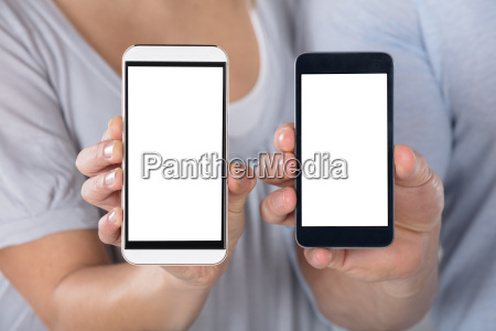 couple showing blank cellphone