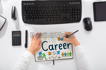 businesswoman drawing career chart on notebook