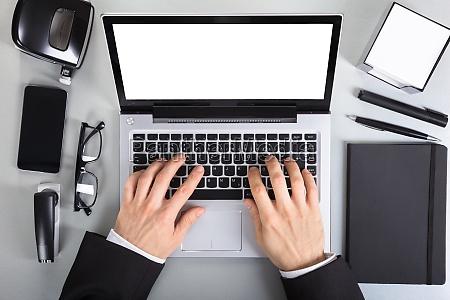 businessperson using laptop
